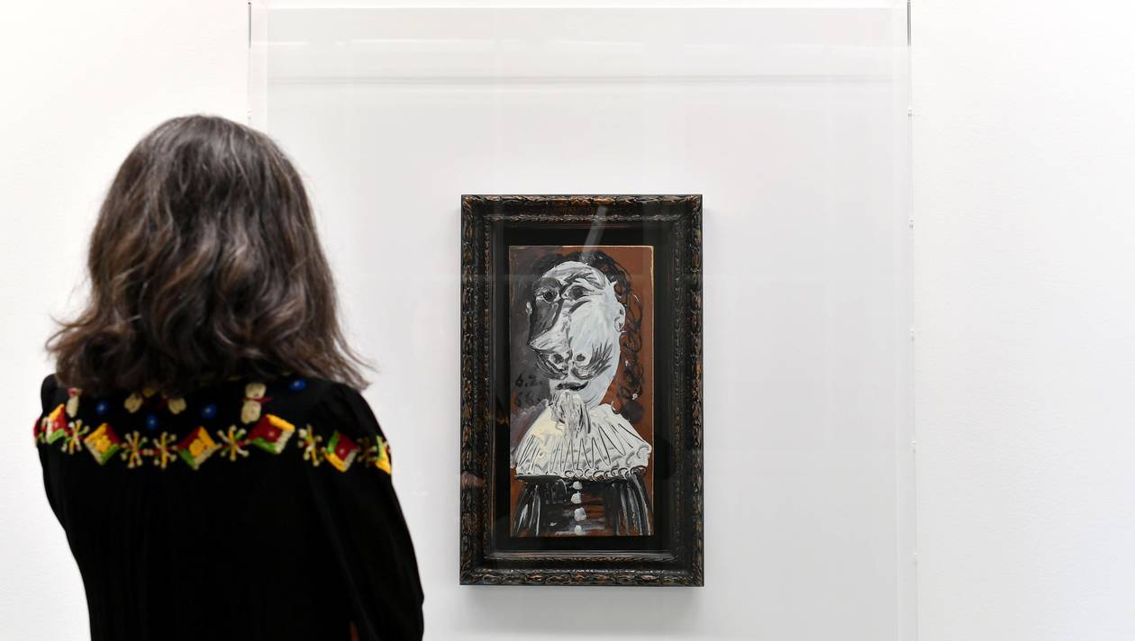 "A visitor looks at a 1968 work by late Spanish artist Pablo Picasso entitled ""Buste de mousquetaire"" at the Museum of Contemprary Art (MAMCO) in Geneva on April 27, 2018.  It might not hang in their living rooms, but they own it nonetheless: 25,000 Internet users banned together to buy a Picasso, which goes on display in Geneva Friday.Usually, visitors to Swiss bargain site Qoqa walk away with a new drill, a suitcase set or a cheap trip to Marrakesh. But last December, the website that was created in 2005 with the motto: ""We do anything, but we do it for you"", proposed a painting by none other than artist superstar Pablo Picasso. - RESTRICTED TO EDITORIAL USE - MANDATORY MENTION OF THE ARTIST UPON PUBLICATION - TO ILLUSTRATE THE EVENT AS SPECIFIED IN THE CAPTION  / AFP / Harold CUNNINGHAM / RESTRICTED TO EDITORIAL USE - MANDATORY MENTION OF THE ARTIST UPON PUBLICATION - TO ILLUSTRATE THE EVENT AS SPECIFIED IN THE CAPTION"